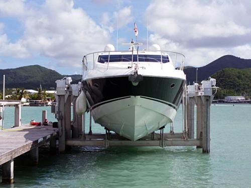 Front view of white and Black boat on an 120,000 pound 8-Post Boat Lift in Antigua.