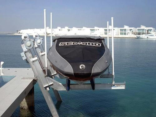front angled view of 7,000 pound elevator lift holding covered boat