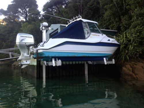 white and blue boat on elevator lift