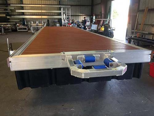 angled shot of aluminum floating dock segment in shop