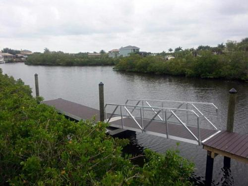 aluminum walkway leading to aluminum floating dock on river