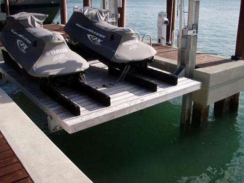 Two black jet skis on a custom Elevator PWC Lift with decking.