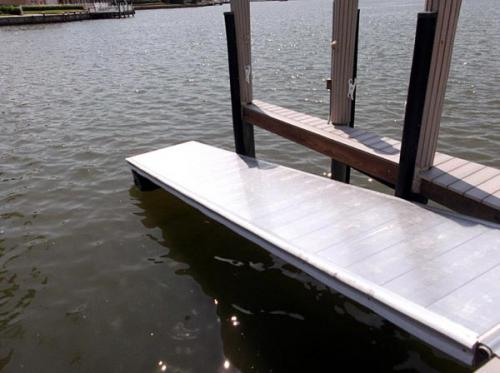 hinged floating access platform on water