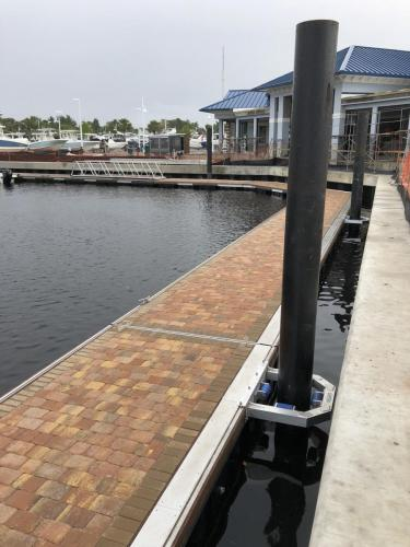 brick textured floating aluminum dock on water