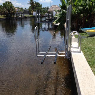 empty kayak launch attached on concrete wall