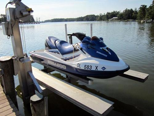 Blue and white jet ski on a pwc lift with walkways.