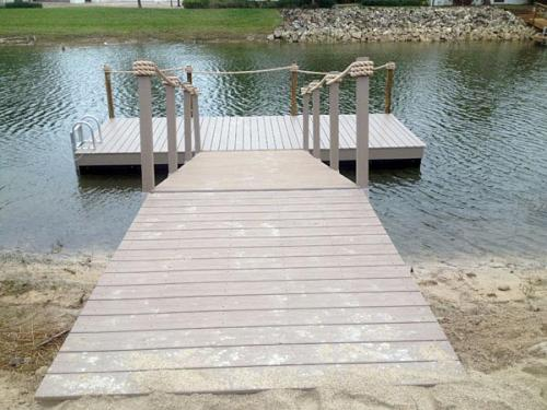 land dock and ramp leading to aluminum floating dock