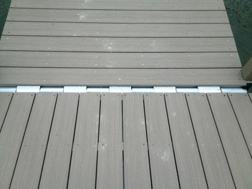 close up of hinge platform of aluminum floating dock