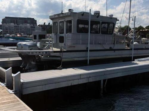 angled view of large boat  in floating boat lift